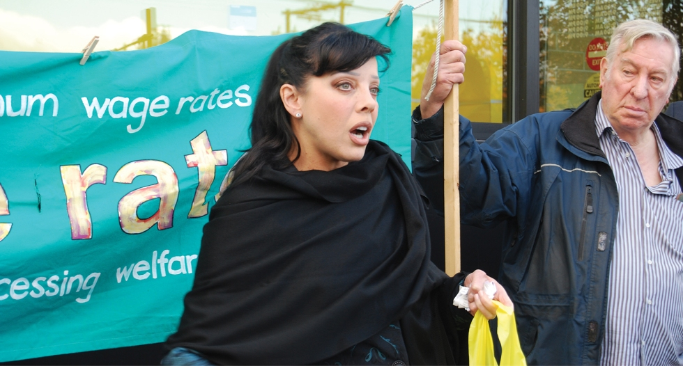 Photo of Bif Naked speaking at the Launch of the 4th Annual Welfare Food Challenge (2015).