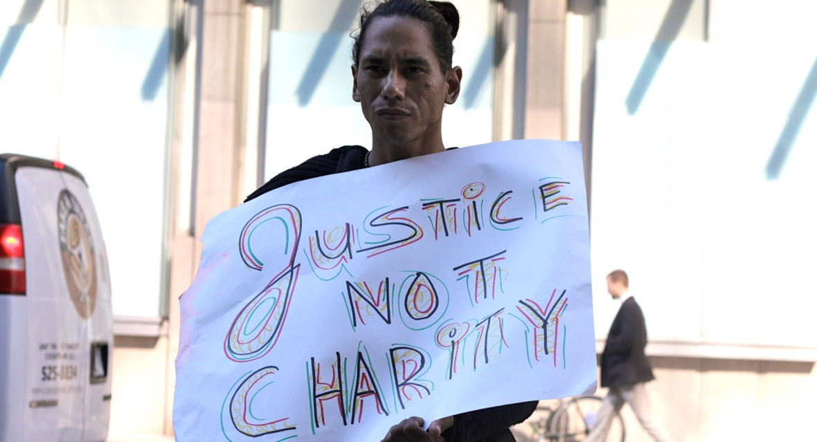 Justice, Not Charity. Photo by Tamara Herman.