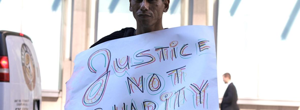 Justice, Not Charity. Photo by Tamara Herman.